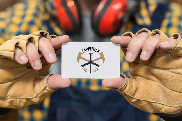 Carpenter holding business card mockup