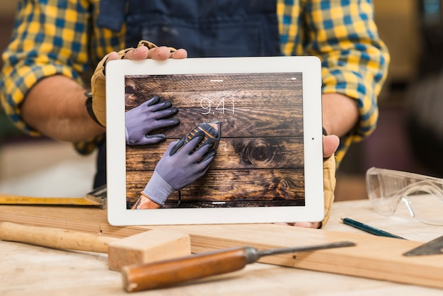 Carpenter holding tablet mockup
