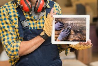 Carpenter holding tablet mockup
