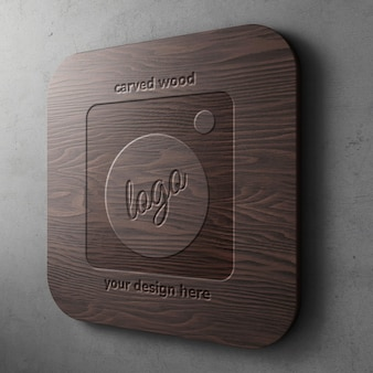 Carved on dark wood logo mockup template on rounded rectangle with concrete wall