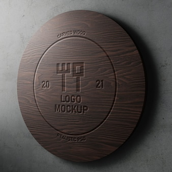 Carved engraved effect realistic logo mockup on modern round wood on concrete wall