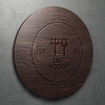 Carved engraved text effect realistic logo mockup on polished round wood perspective