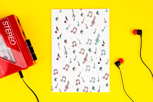 Cassette with headphones and musical notes on sheet