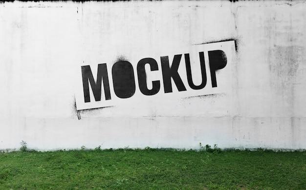 Cement yard wall mockup with graffiti