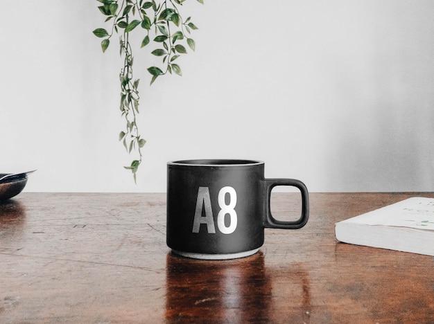 Ceramic coffee cup on desk mockup