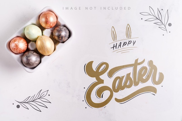 Ceramic egg tray with gold and silver painted easter eggs on white stone mockup surface,