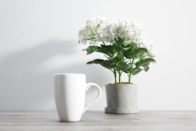 세라믹 찻잔 및 화분 안에 꽃