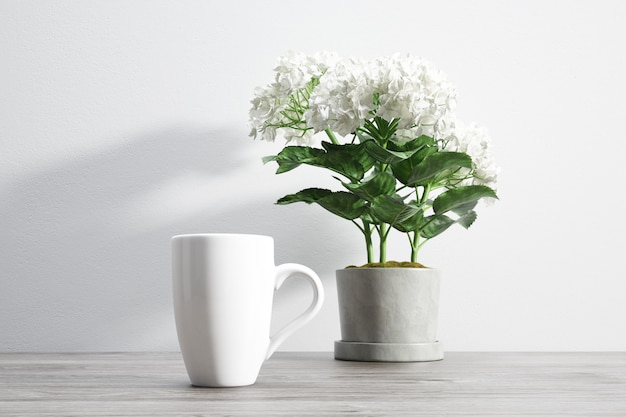 Ceramic mug and flower inside flowerpot