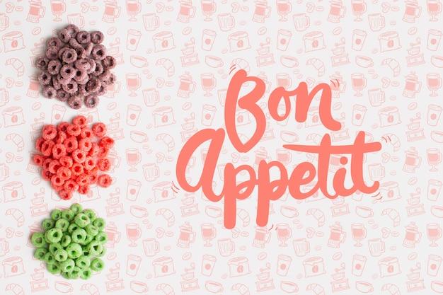 色で分けられた穀物とボナペティのメッセージ