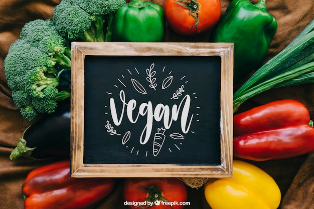 Chalkboard mockup with vegetable designs Free Psd