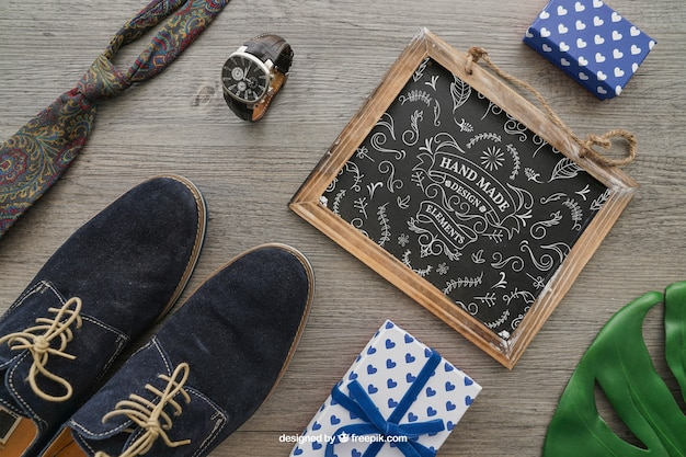 Chalkboard, shoes, tie, watch and gift boxes