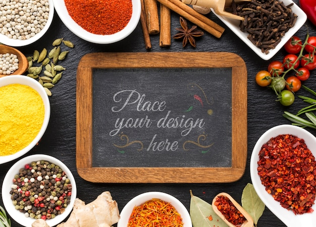 Chalkboard with wooden frame mock-up surrounded by spices and herbs