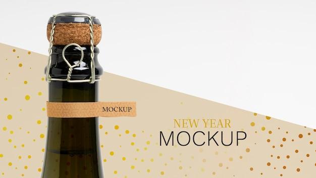 Mock-up di bottiglia di champagne e tappo in sughero