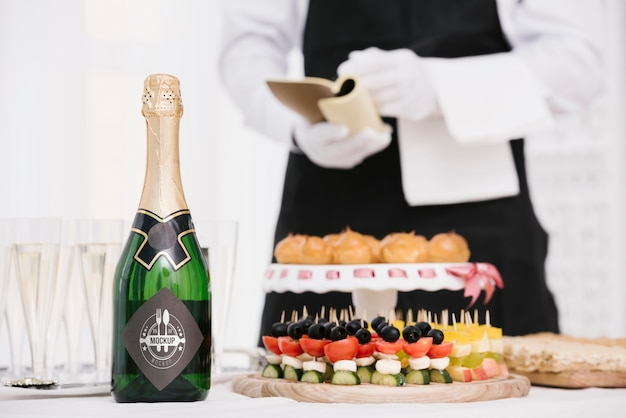 Champagne next to catering food