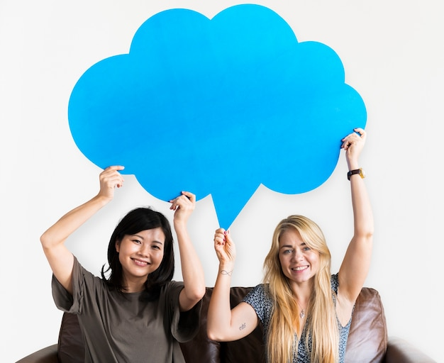 Cheerful couple holding speech bubble icon