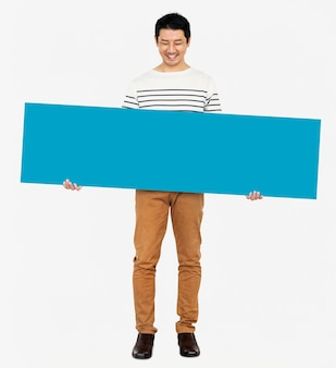 Cheerful man holding a blank blue banner