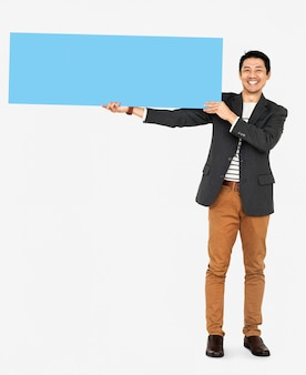 Cheerful man showing a blank blue banner