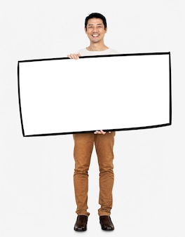 Cheerful man showing a blank white banner