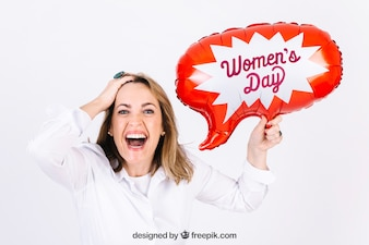 Cheerful woman with speech bubble balloon for event