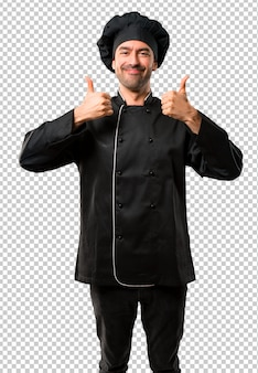 Chef man in black uniform giving a thumbs up gesture and smiling because has had success