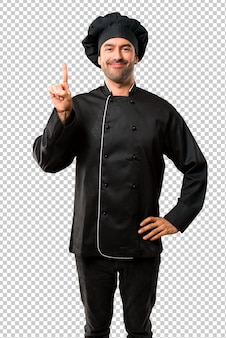 Chef man in black uniform showing and lifting a finger in sign of the best