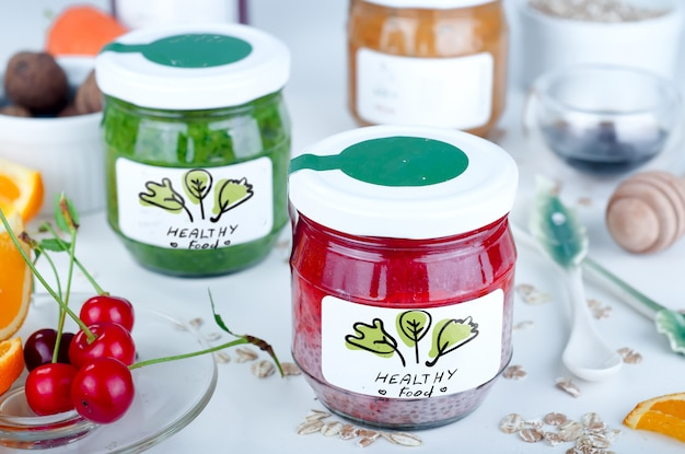 Chia and strawberry puree in jars
