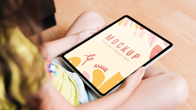 Child holding a tablet digital mock-up