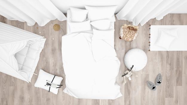 Детская спальня с кроватью и множеством игрушек. вид сверху