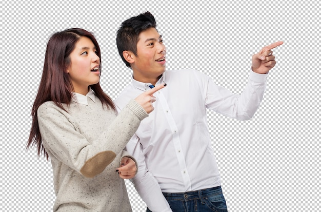 Chinese couple pointing copyspace