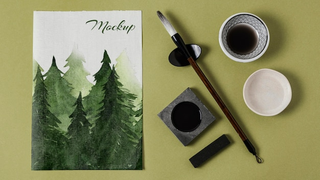 Composizione di elementi di inchiostro cinese con carta mock-up