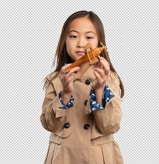Chinese little girl holding a plane