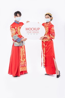 Chinese man and chinese woman hold blank speech bubble mockup