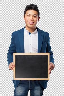 Chinese man holding chalkboard