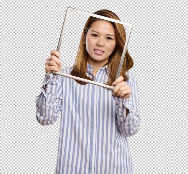 회색 프레임을 들고 중국 여자
