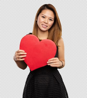 Chinese woman holding a heart shape