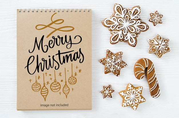 Christmas background with brown notebook mockup and gingerbread cookies