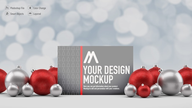 Christmas card mockup next to christmas balls and blur background
