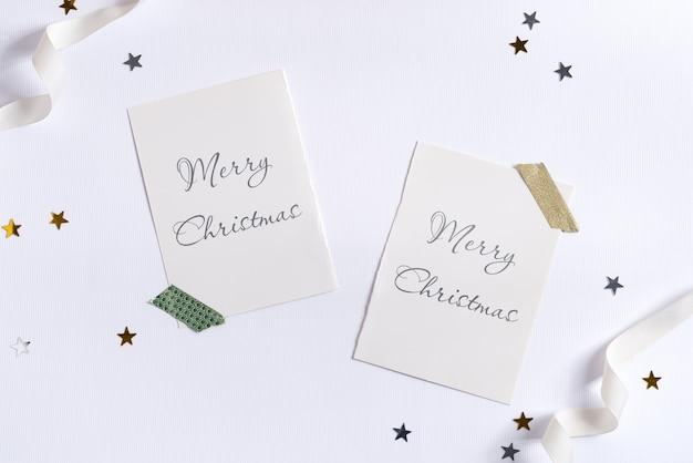 紙吹雪とモックアップカードのクリスマスカード