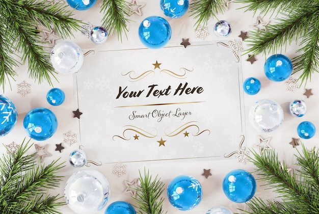 Christmas card on wooden surface with christmas ornaments mockup