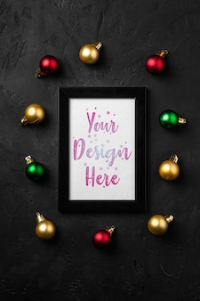 Christmas composition with empty picture frame. colorful ornament decorations. mock up greetings card template