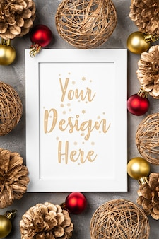 Christmas composition with empty picture frame golden ornament pine cones decorations mock up greetings card template