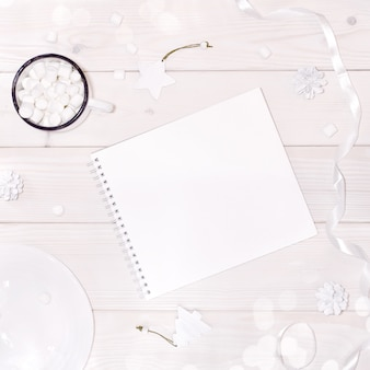 Christmas composition with notepad mockup with white decorations