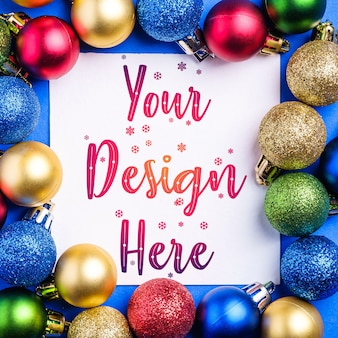 Christmas composition with white square copy space. colorful ornament and baubles decorations. mockup greetings card template