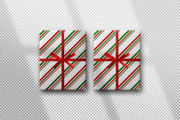 影付きの赤いリボンのモックアップとクリスマスギフトボックス