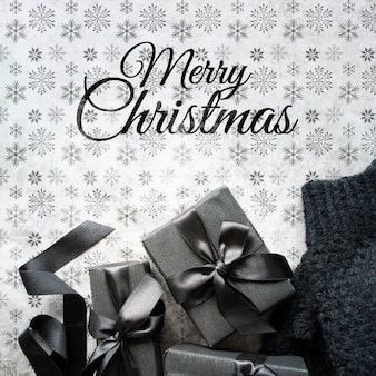 Christmas gifts on cute background with snowflakes