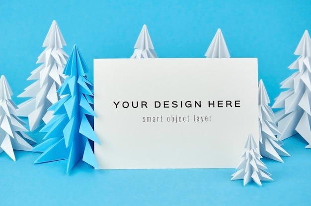 Christmas greeting card mockup with blue and white paper fir trees