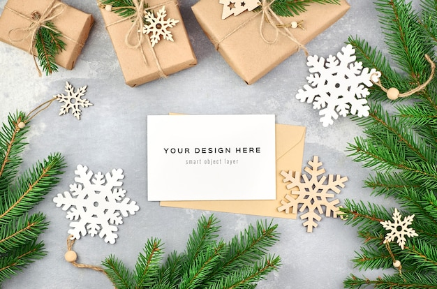 Christmas greeting card mockup with christmas tree branches and decorations