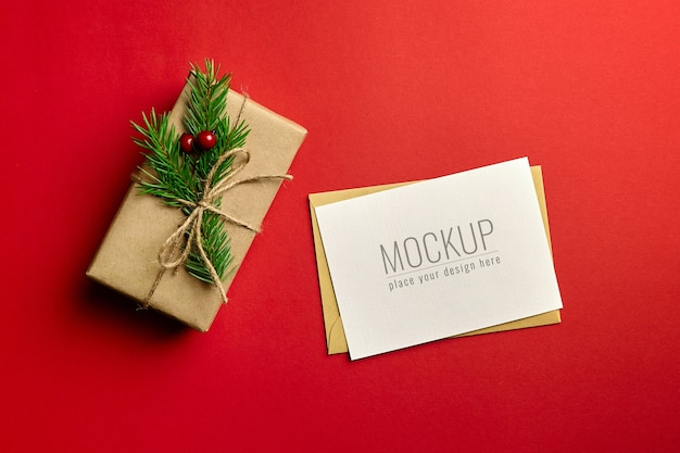 Christmas greeting card mockup with decorated gift box