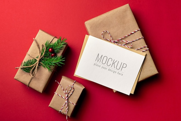 Christmas greeting card mockup with decorated gift boxes