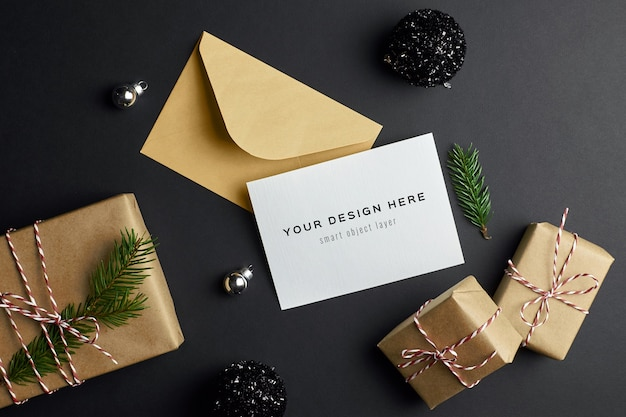 Christmas greeting card mockup with fir tree branch, gift boxes and festive decorations